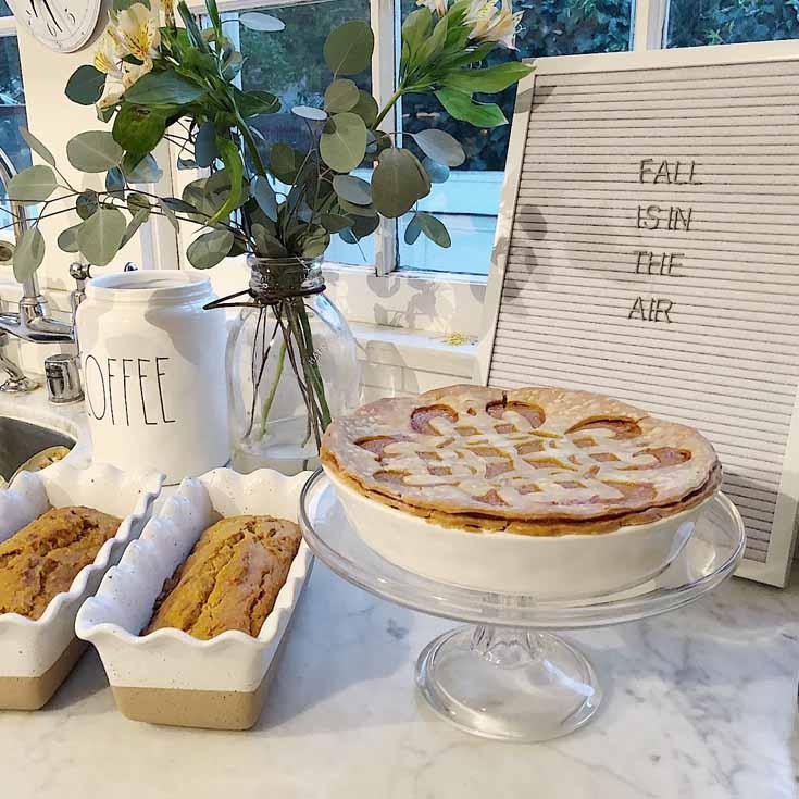 pumpkin pie on a white countertop