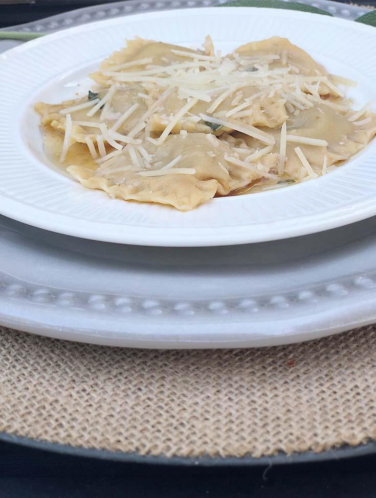 pumpkin ravioli on a white plate