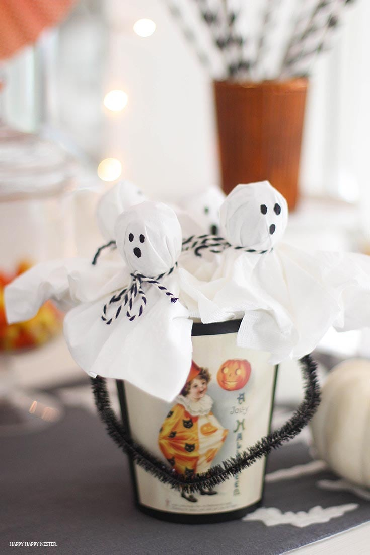 cute lollipop ghosts in a Halloween container
