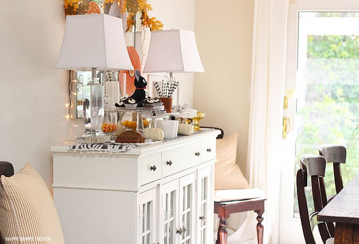 white buffet with halloween decor on it