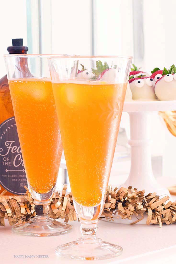 orange sparkling drink in tall glasses