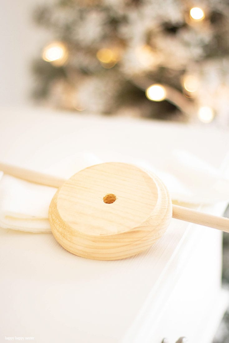use a wooden dowel and base for a fleece christmas tree