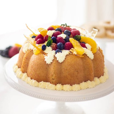 Here is a Yeast Cake Recipe that is soaked thoroughly in an Orange Grand Marnier syrup. This cake is topped with a Sabayon cream frosting and fresh fruit. This unique yeast cake is a bit rustic and very gourmet in taste. It is an impressive cake. Cake | French Cake | Baking | Gourmet Desserts | European Cake