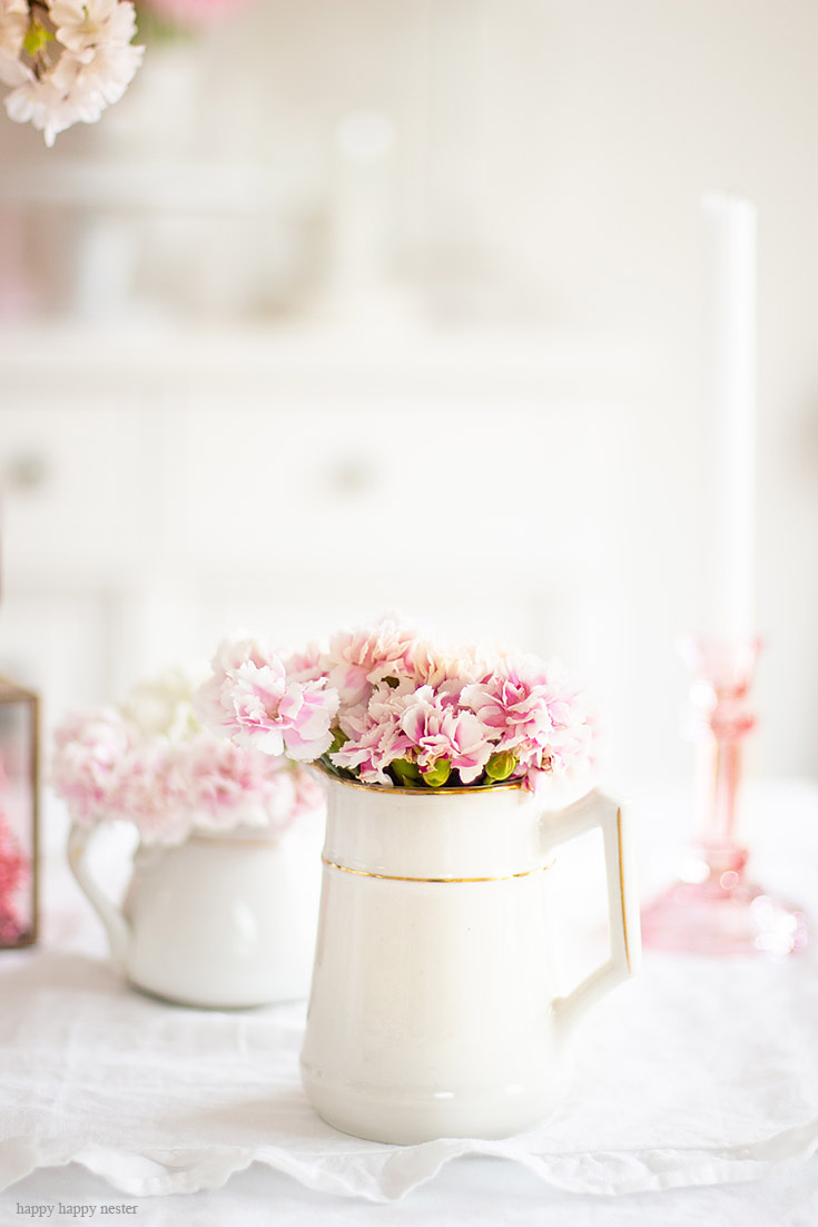 Find creative ways to add flowers to your spring home. The best way to say goodbye to winter is a Pretty Pink Spring Home Tour. I love how happy the color pink is, and it is so pretty in our living room, entry and dining room. Adding fresh flowers brightens a home and welcomes family and friends with a warm embrace. #decorating #springdecor #springtour #pinkdecor #hometour