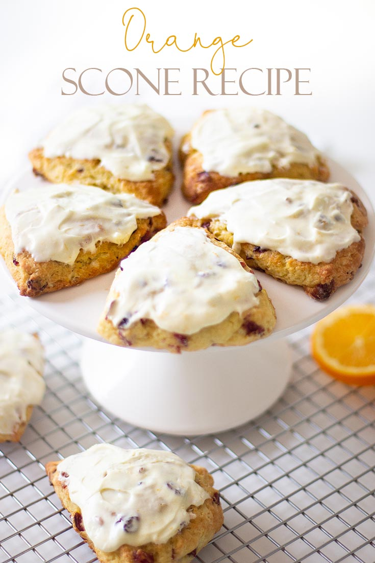 This Fresh Orange Scone Recipe is the perfect blend of orange and cranberries and a creamy, moist dough. Cold shredded butter and minimal handling of the dough is the key to a fluffy English scone. Orange zest and juice is a delicious pair to cranberries. #baking #scones #joannagaines #favoriterecipes #englishscones