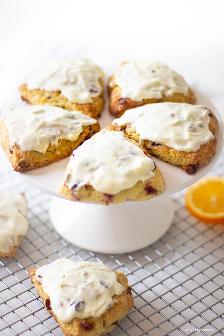 This is the best orange cranberry scone recipe. This Fresh Orange Scone Recipe is the perfect blend of orange and cranberries and a creamy, moist dough. Cold shredded butter and minimal handling of the dough is the key to a fluffy English scone. Orange zest and juice is a delicious pair to cranberries. #baking #scones #joannagaines #favoriterecipes #englishscones