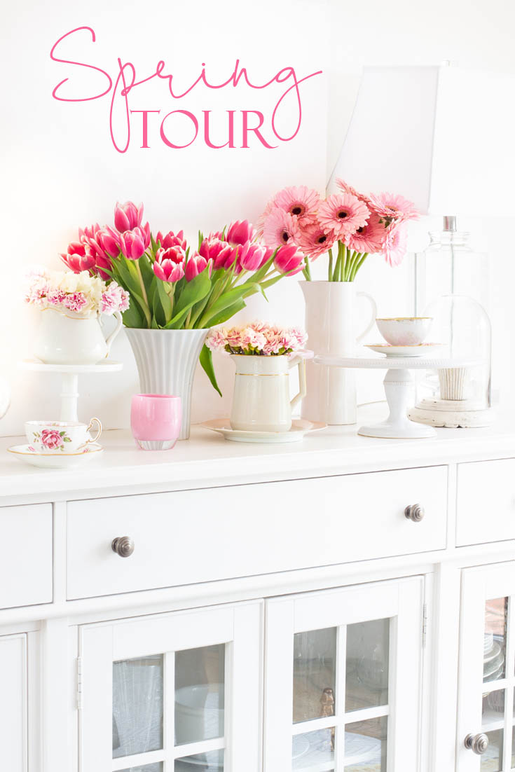 The best way to say goodbye to winter is a Pretty Pink Spring Home Tour. I love how happy the color pink is, and it is so pretty in our living room, entry and dining room. Adding fresh flowers brightens a home and welcomes family and friends with a warm embrace. #decorating #springdecor #springtour #pinkdecor #hometour