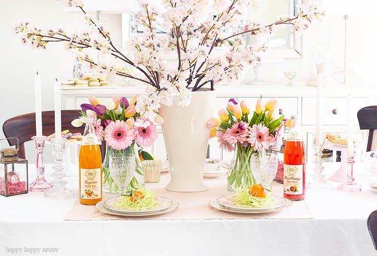 A Spring Table is Always Great for Easter. Need some help with your Spring Floral Arrangements? I came up with an easy and pretty bouquet using simple tulips and daises. It takes a few minutes to make and your home is bursting with spring happiness. You don't have to spend much time and money on your flowers. #flowers #springflowers #floralarrangements #tulips