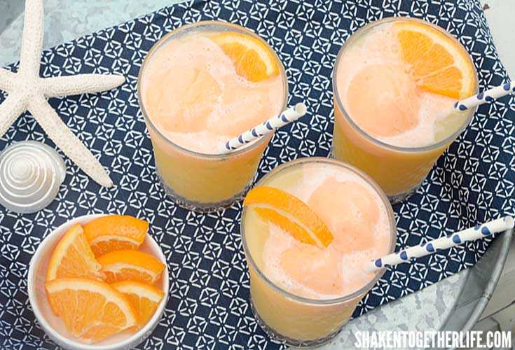 Tropical Orange Sherbet Punch. Here are 10 Non-Alcohol Summer Drinks that you'll love. Need some recipes this summer, well, we have you covered if you need slushies, teas, fruit drinks and more. These bloggers have tested them, and these are their favorites. #drinks #summerdrinks #cocktail #drinkrecipes #recipes #happyhour #weddings #weddingdrinks