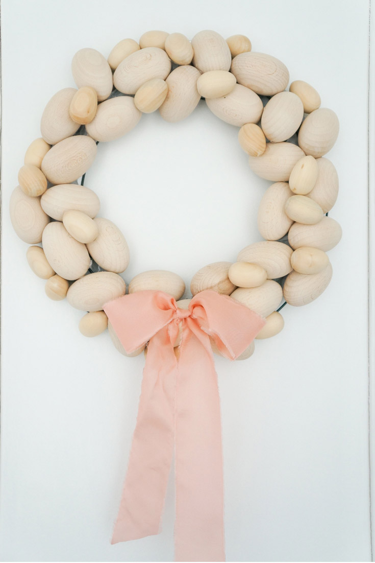 Beautiful Wooden Egg Wreath. 9 Unique Easter Egg Ideas with so many different styles. Easy projects that are perfect for Easter. There are decoupaged eggs, gilded eggs, and painted eggs all so pretty and easy to create. 9 bloggers come together for this great post. #crafts #easter #eastereggs #decoratingeggs #easterdecorating #decoupageeggs