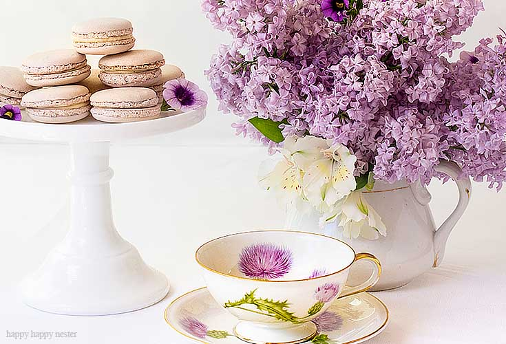 Need ideas on how to decorate your spring table? It doesn't take much to create a Beautiful Spring Table with Fresh Flowers. This spring table with fresh lilacs and other garden flowers is so easy to create. No need to spend much to style a fabulous spring table. #springtable #flowerbouquet #freshflowers #lilacs #lavendertable #decoratingwithlilacs #purplelilacs