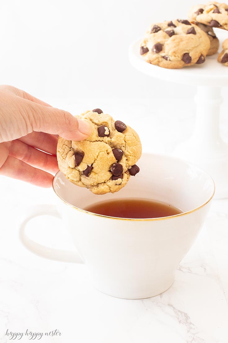 This delicious cookie is our longtime family favorite Chocolate Chip Cookie Recipe! This chocolate chip cookie will surprise you with its crunchy quality that is packed with loads of chocolate chips and nuts. I'm certain you have never had a chocolate chip cookie like this one! #cookie #chocolatecookie #baking #cookierecipe #bestcookie #bestchocolatechip