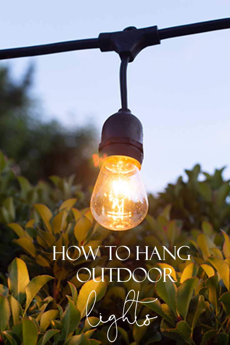 This tutorial shows How to Hang Outdoor String Lights for your summer patio. Learn how with step by step instructions on how to install a wooden post into cement. #diy #homeimprovement #outdoorlights #summerproject