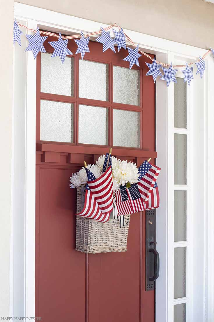 This DIY Paper Stars for 4th of July Garland is an easy and inexpensive holiday banner. Get the free printable, cut and fold and string it on a cute ribbon. #4thofjuly #garland #crafts #papercrafts #summerproject #diy #paper