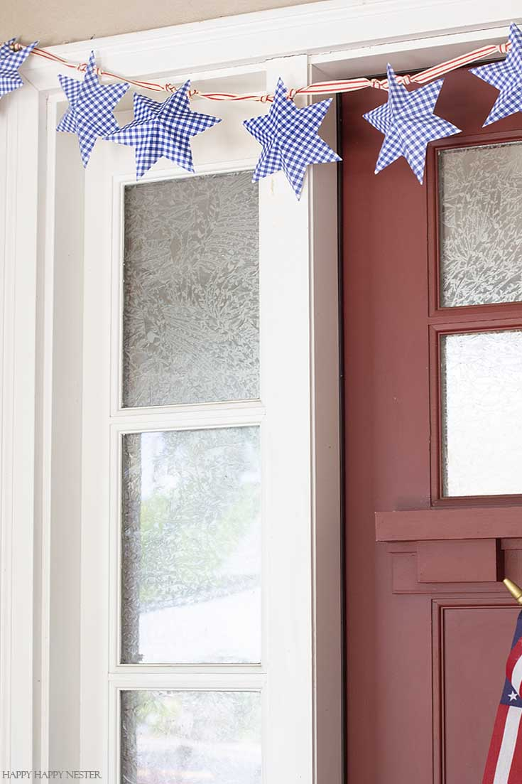 Create this 4th of July Star Garland out of paper and a free printable. Add a cute ribbon and hang it on your door or wall. Easy to follow video tutorial shows how to make this pretty star garland. #paperproject #diy #garland #papercrafts #crafts #4thofJulyproject #homedecor