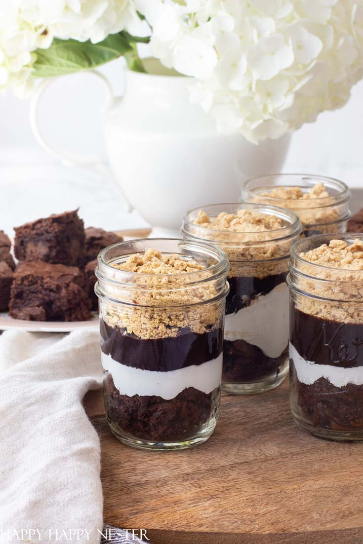 Need a tasty treat? This S'mores Recipe in a Jar is a yummy choice if you want a different version of a s'more. No need to roast your marshmallows. #s'mores #s'moresrecipe #desserts #chocolatebrownies #chocolatedesserts
