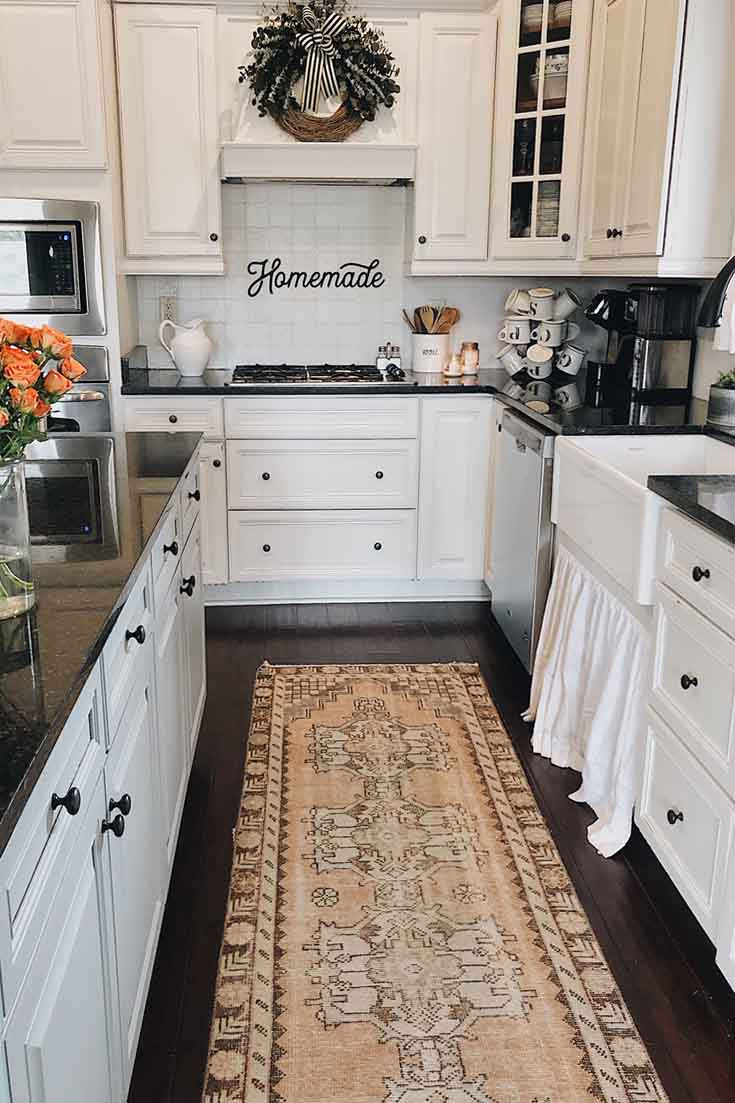 Can you believe that these kitchen cabinets are painted by the owner? View the fabulous transformation of this kitchen. #remodel #kitchenremodel #paintedcabinets #diy