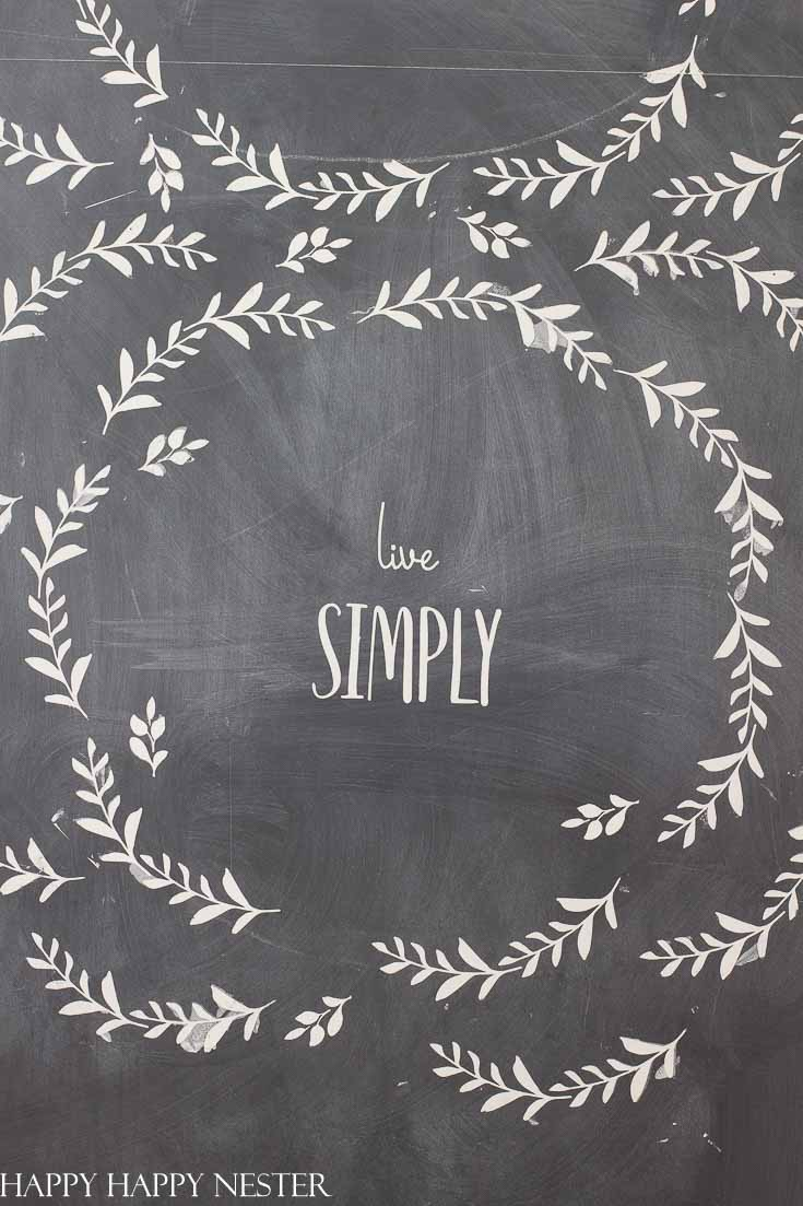 This chalkboard design utilizes A Makers' Studio stencils and paint. They make it easy to create art for your chalkboard. #chalkboard #artwork #stencils #chalkart