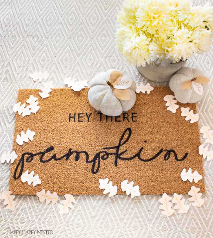 Have you ever wondered How to Stencil a Cute Doormat? I was surprised by how easy they are to stencil. Once you have your stencil, it takes minutes to paint. And this post includes a free stencil printable. #stencil #falldoormat #cutedoormat #craft #craftproject