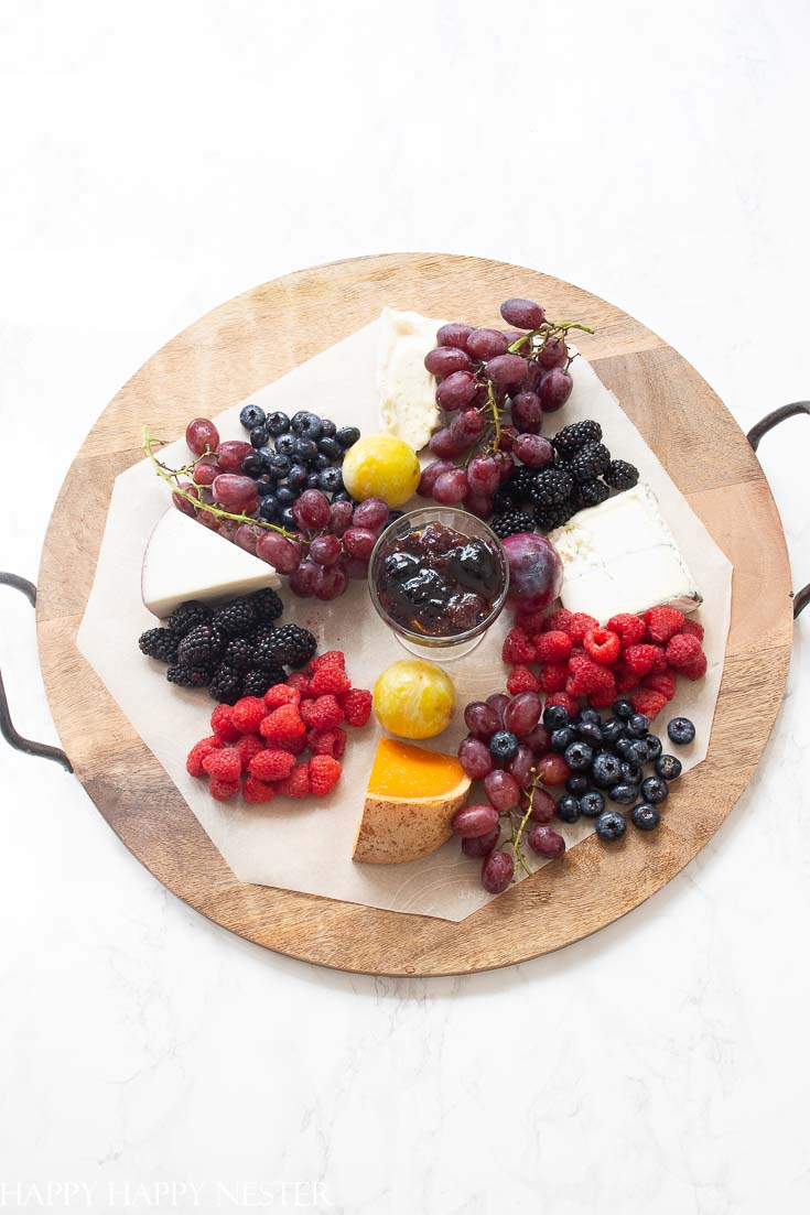 Need some Easy Appetizer Ideas for a Party, then you'll want to view this step by step tutorial. It shows how to build a fruit, cheese charcuterie board. These amazing boards with delicious gourmet foods will impress your guests! Get started on this great appetizer and you'll create a ton of wonderful party foods. #appetizers #easyappetizers #charcuterieboard