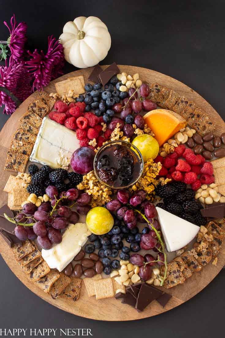 Charcuterie boards are the best for display appetizers. Pick out a round, square or rectangular, one and then build all your food on it. They are perfect for a big crowd of friends or family. You'll never run out of great appetizers to add to your board. #charcuterieboards #entertaining #partyappetizers #appetizers #appetizerdiy