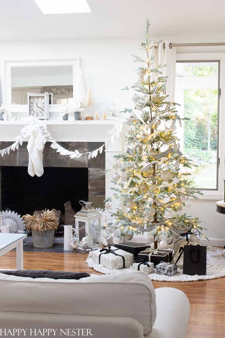 Looking for a realistic faux Christmas tree? This Balsam Hill Christmas Tree Review will help you decide about purchasing the Frosted Alpine Balsam Fir. This post reviews the branches, needles, lights, and ease of putting it together. It is a big investment so take the time to do your research. I certain you'll find this post helpful and informative. #balsamhill #balsamhilltrees #fauxtrees