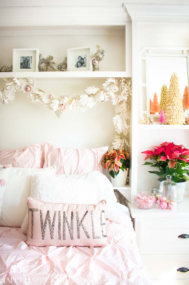Who says you can only decorate only in red and green? Well, if you love pink and red then check out this great post. Easy Vintage Christmas Bedroom Decor is a bright and pink winter wonderland. It's a fun and happy room decked out in vintage ornaments and pink poinsettias. #christmasbedroom #craneandcanopybedding #Christmasdecor #vintagedecor