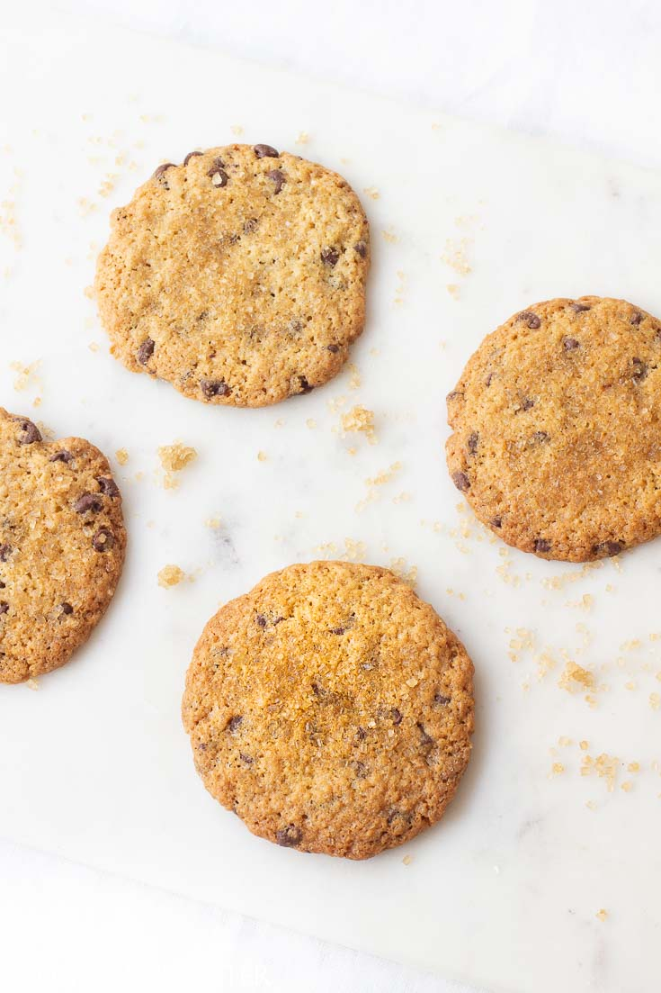 This is the best chocolate chip cookie recipe. You'll love how crispy it is on the edges and how chewy it is on the inside. All wrapped up in a sugary butter topping. #cookierecipe #chocolatechipcookie #baking #cookie #chocolate