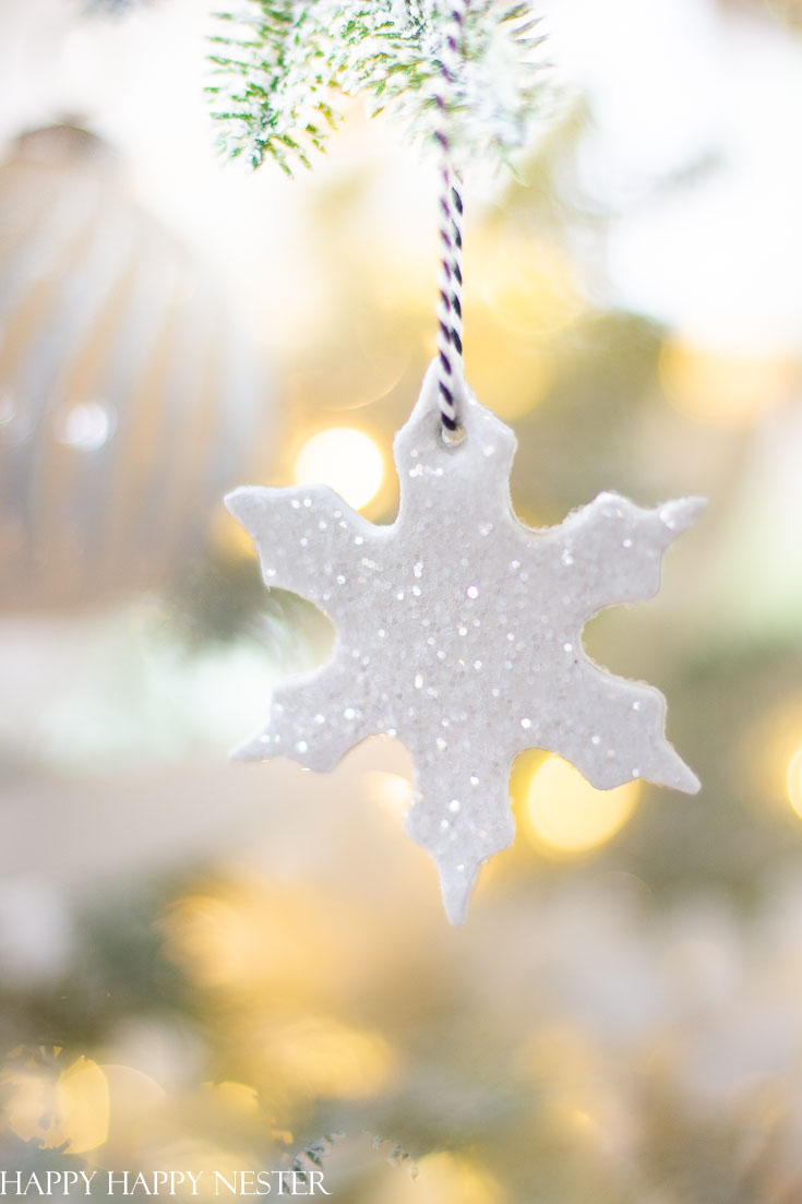 Make this easy clay ornament this holiday. Add a bit of crystal clear glitter to add a bit of sparkle and attach a cotton twine string to hang it from the tree. This is such an easy holiday diy that even your kids will love joining in on this project. #crafts #kidcrafts #ornaments #christmasornaments