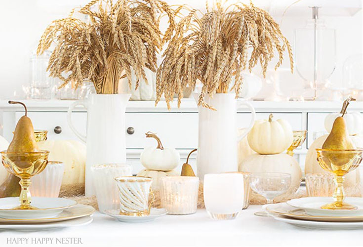 A Thanksgiving Table doesn't have to be expensive. Add natural elements to create a warm and inviting table. Wheat, pumpkins, and fruit are inexpensive and beautiful and add that perfect touch of Autumn! #wheat #thanksgivingtable #thanksgiving #tabledecor