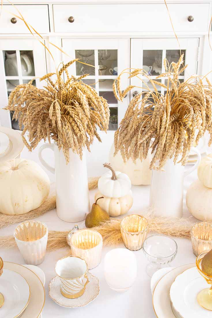 Here is a Thanksgiving Table Setting Made Easy. Find out how to set a Thanksgiving table step by step. This table has all-natural elements and wheat makes a beautiful fall centerpiece for a table. #thanksgiving #thanksgivingtable #tabledecor #createathanksgivingtable #tablesetting
