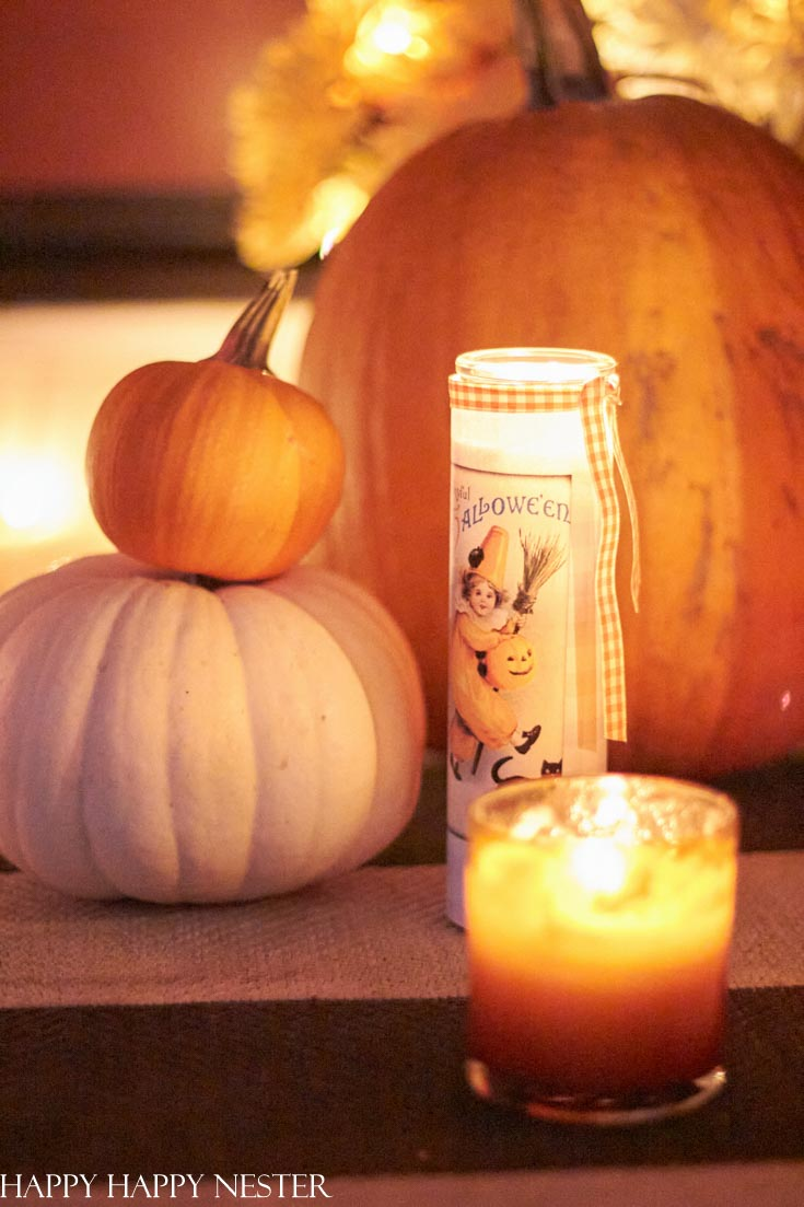 Use candles to warm up your Halloween decor