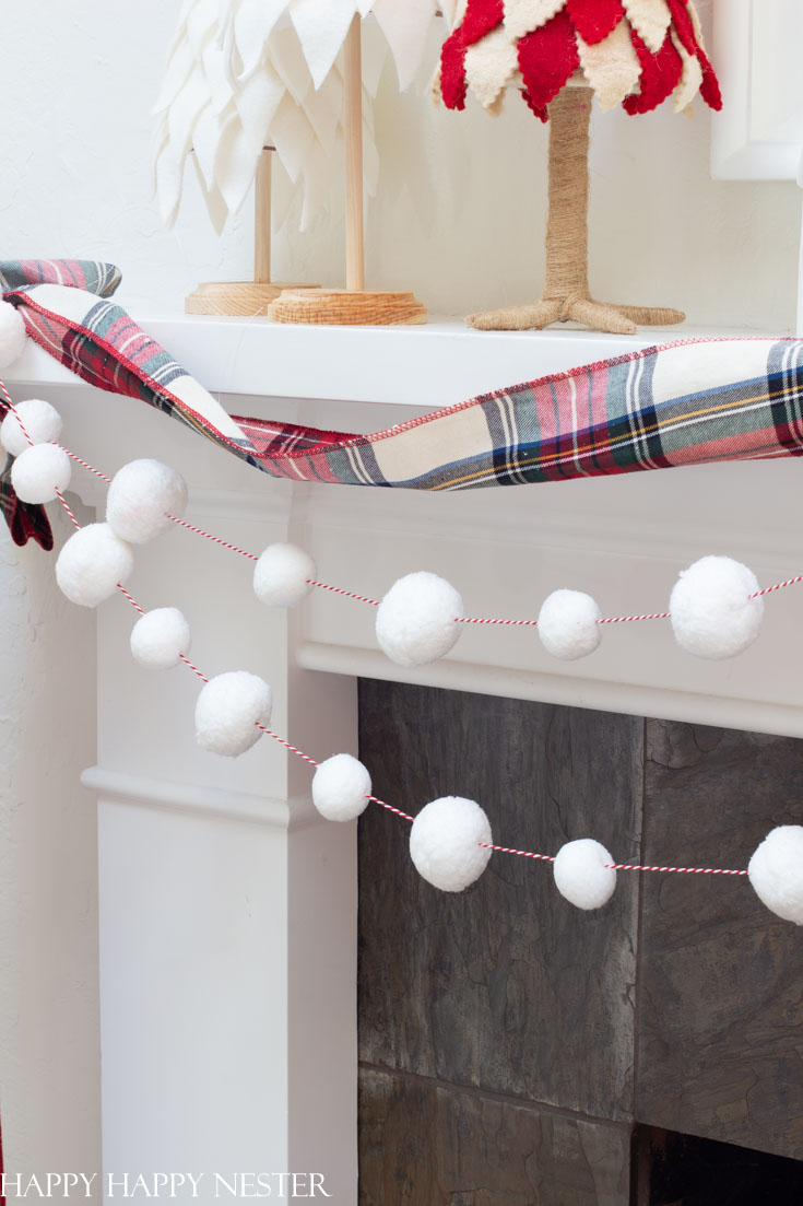 Make this terrific easy garland for the holidays. It only takes a couple of minutes to create and the results are this cute snowball garland.