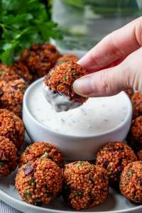 QUINOA PIZZA BALLS recipe dipping a ball in ranch dip