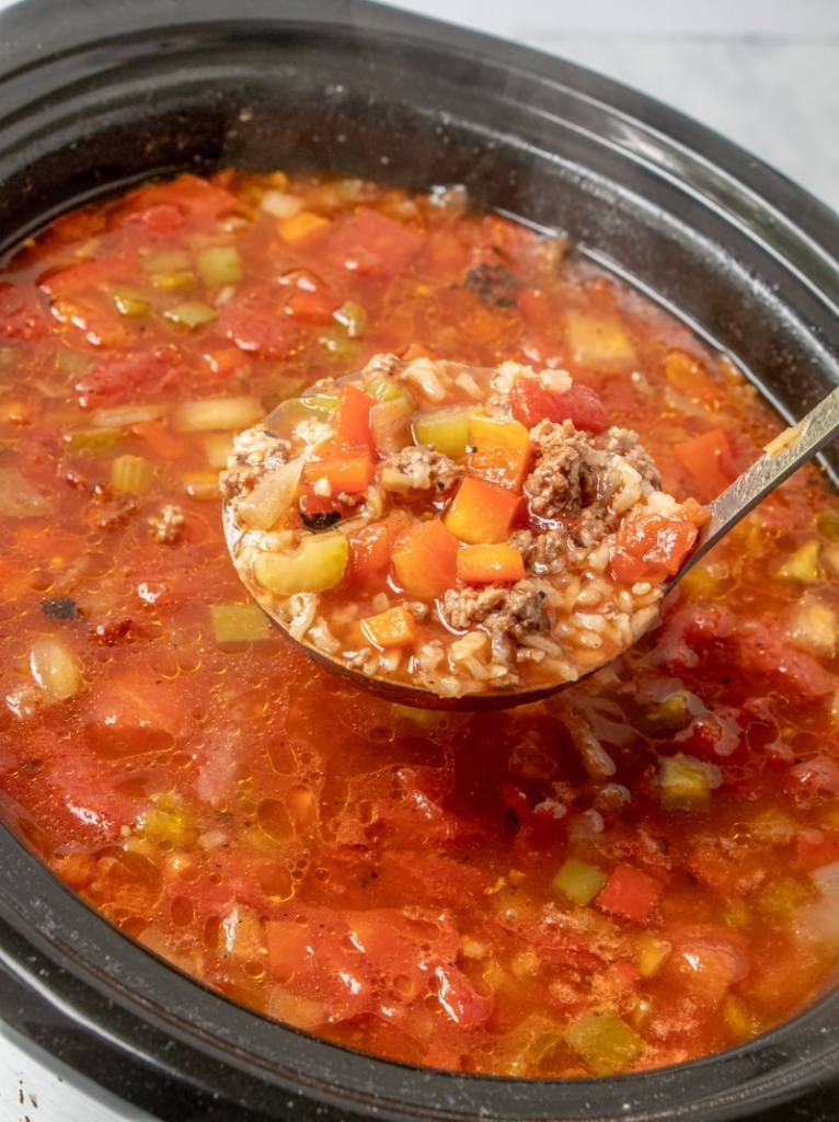 SLOW COOKER STUFFED PEPPER SOUP recipe ladling a serving from crockpot