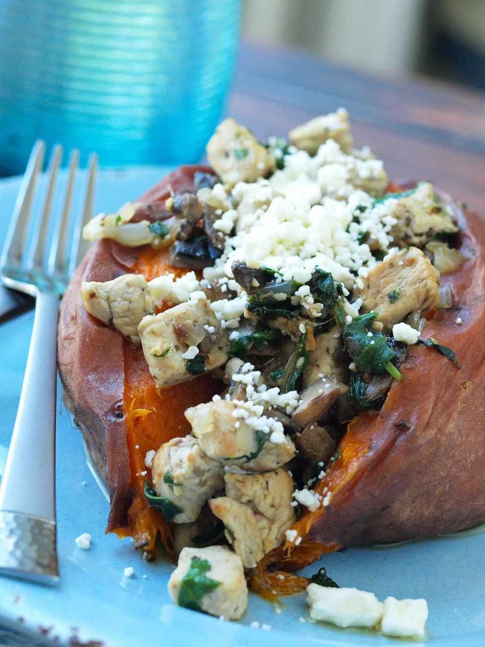 Chicken, Spinach, Mushroom, and Feta Stuffed Sweet Potato Recipe. You can cook the sweet potatoes in the crockpot, and the rest of the recipe takes less than 20 minutes! This is a great healthy recipe for a quick weeknight dinner! Clean eating and gluten-free.