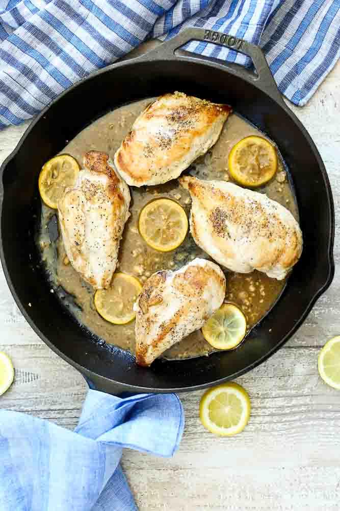 Cast Iron skillet with Easy Lemon Skillet Chicken prepared