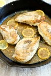 Close up picture of Easy Lemon Skillet Chicken Recipe in cast iron skillet pan