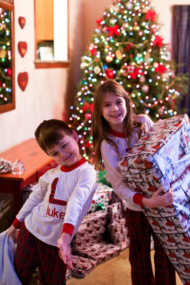 Meghan and Luke wearing the same Christmas jammies 3 years later