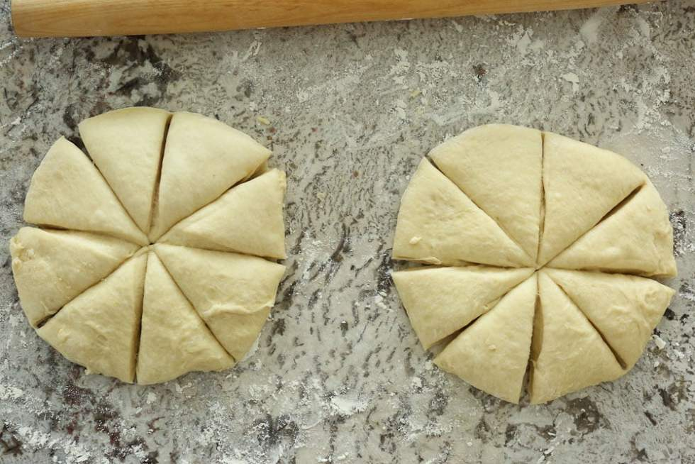 Perfect Bread Machine Dinner Rolls--two dough circles cut into eights with a rolling pin