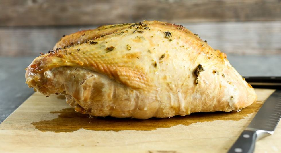 Roasted Turkey Breast Recipe the whole breast on a cutting board