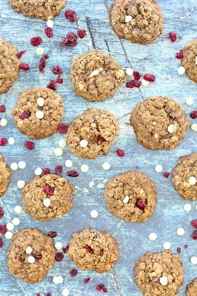 Cranberry White Chocolate Chip Oatmeal Cookies--the whole batch on the table with extra cranberries and white chocolate chips