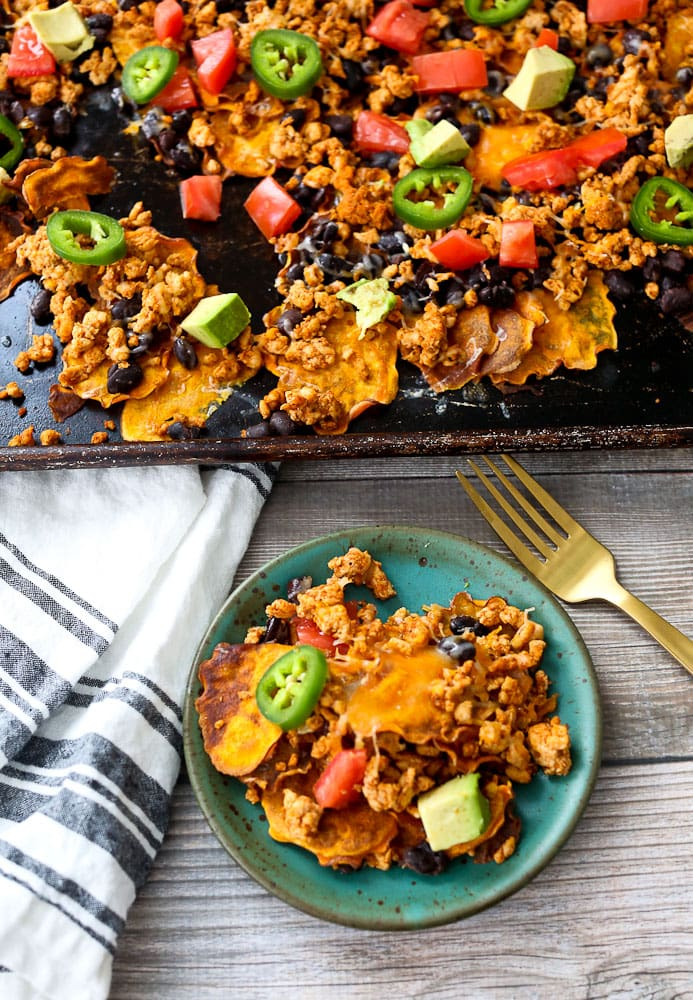 Sweet Potato Nachos recipe one serving on a plate with the tray of nachos