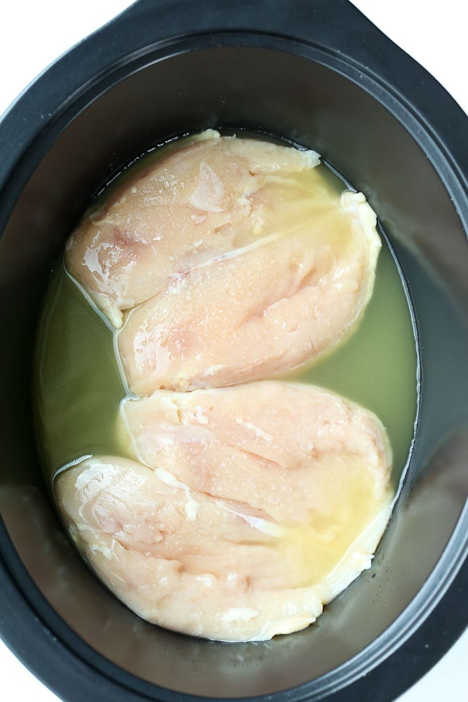 Crockpot Shredded Chicken recipe dinner ideas raw boneless skinless chicken breasts in the slow cooker with broth