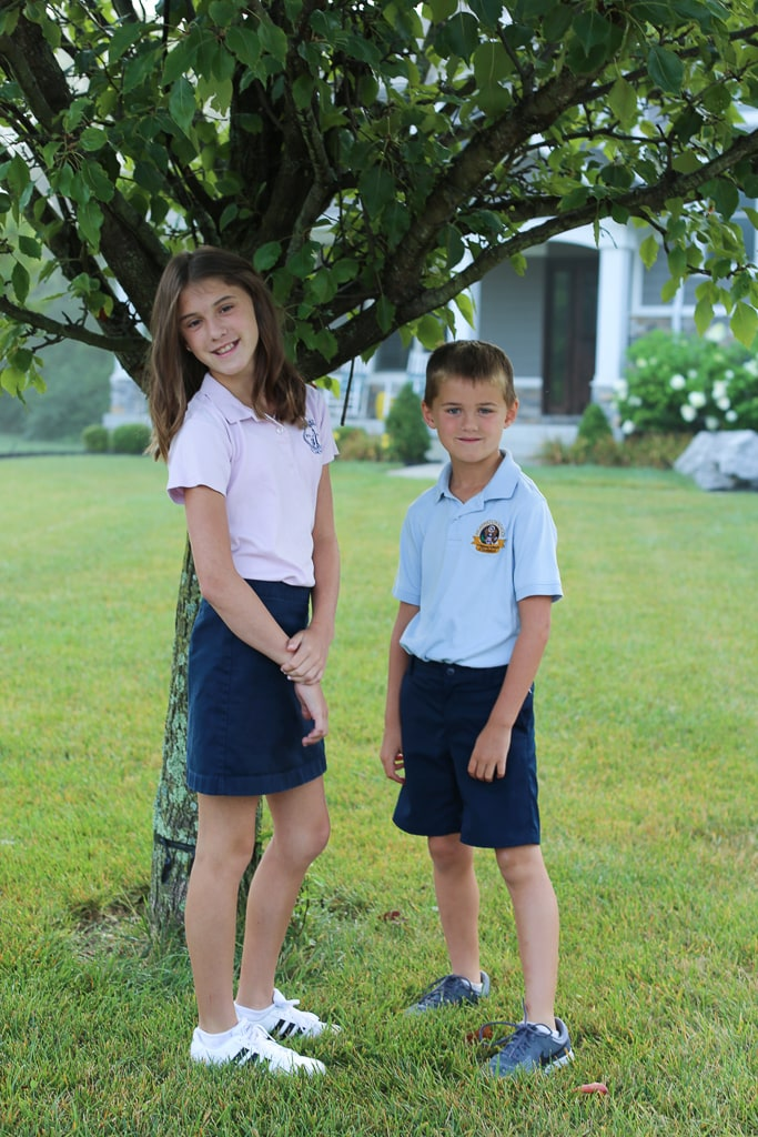 Meghan and Luke first day of school 2019 in front of tree