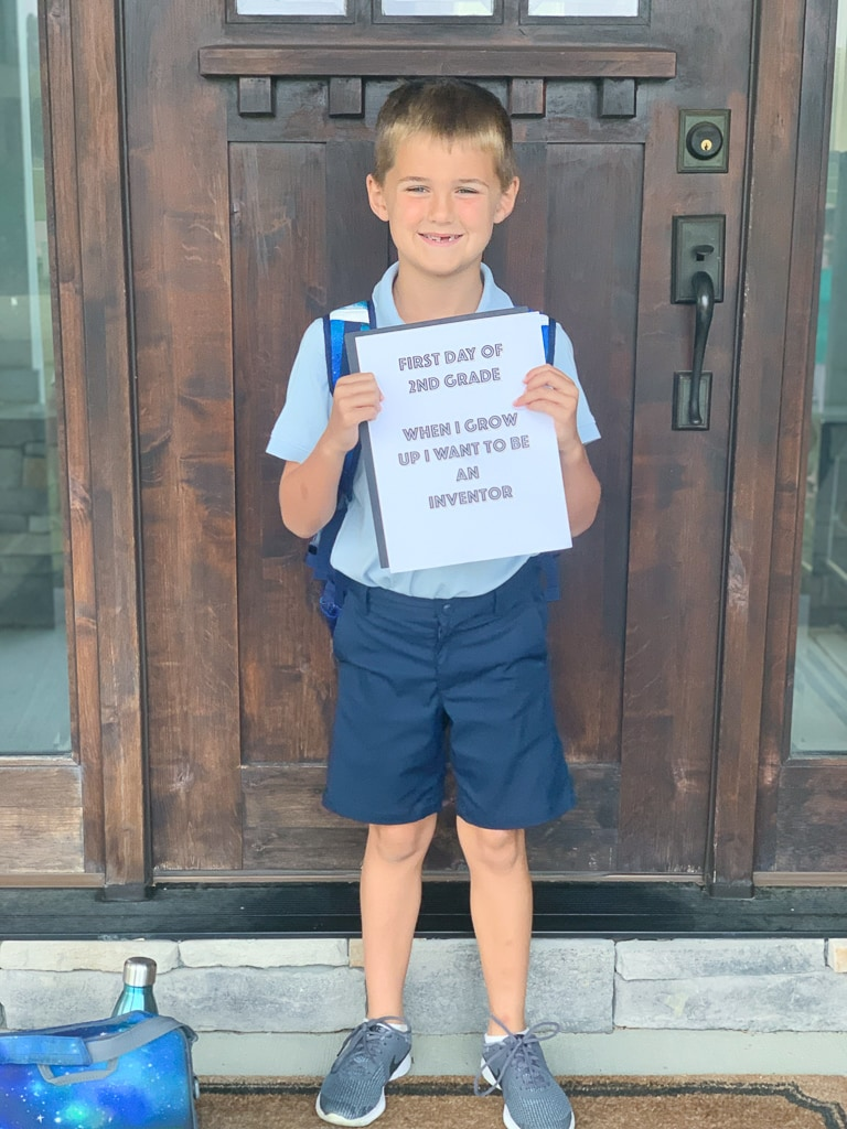 Luke first day of school 2019 in front of door