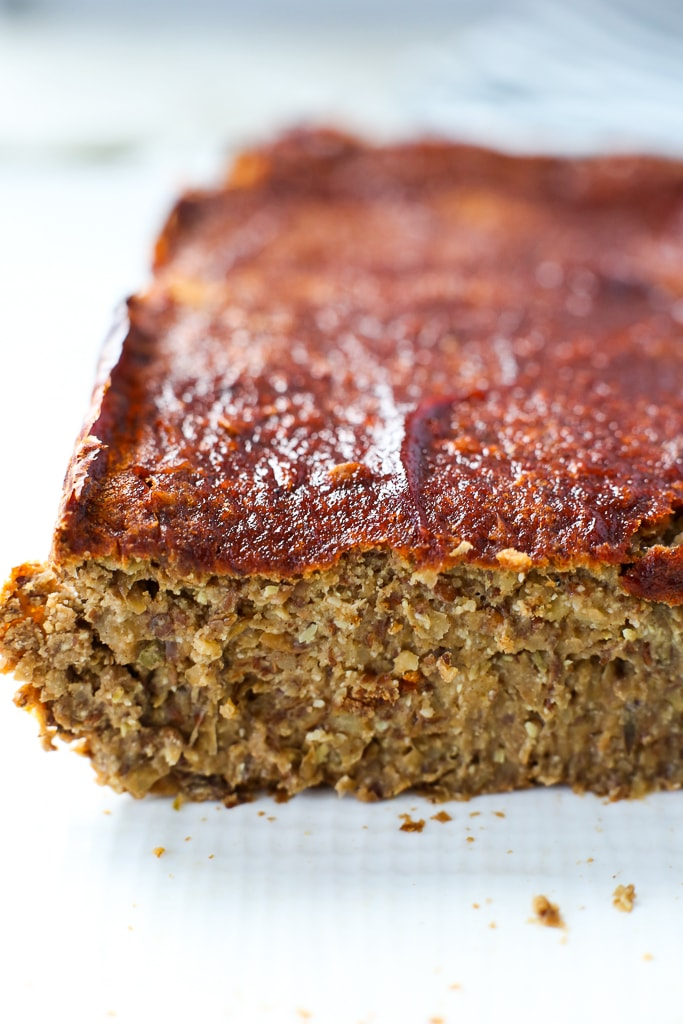 Up close picture of a lentil loaf showing the texture with ketchup on tp