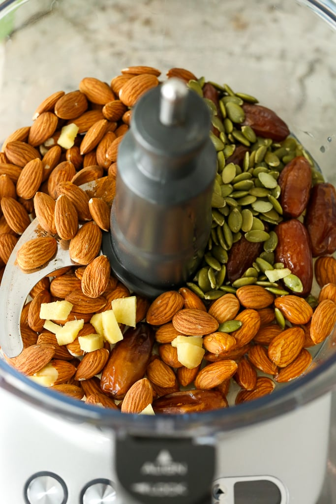 almonds, ginger, pumpkin seeds, and dates in a food processor with the lid off