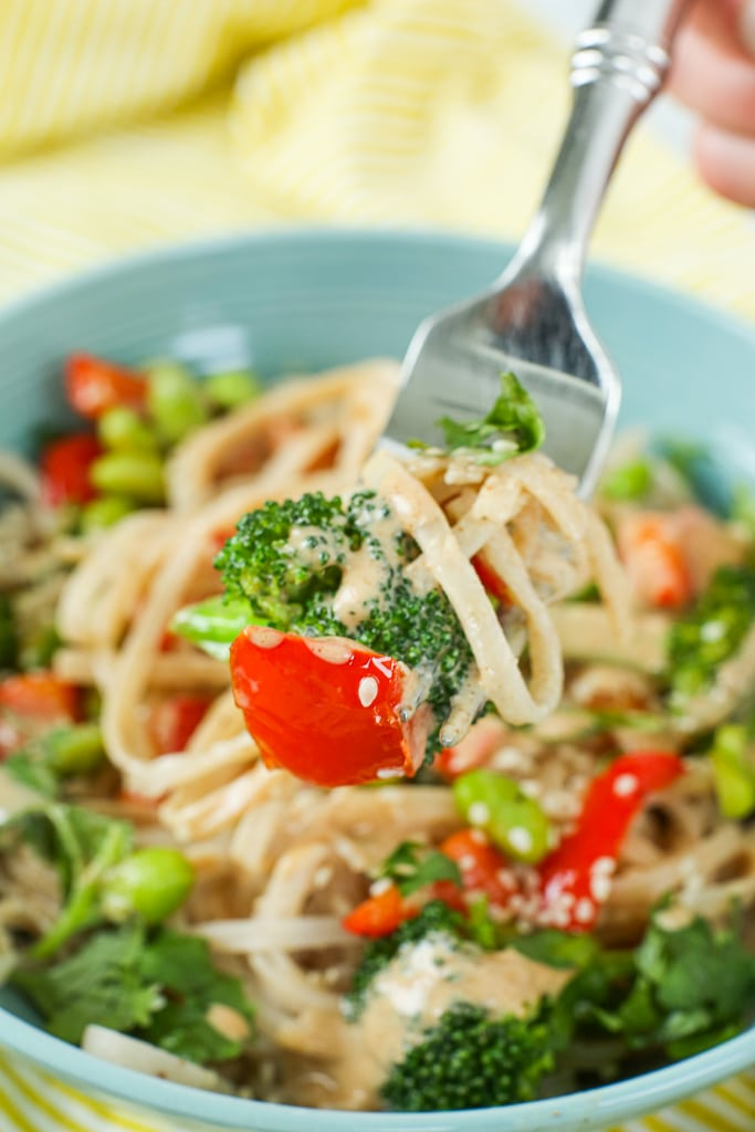 Vegan Asian Noodle Bowls recipe up close picture of red pepper broccoli and rice noodles on a fork