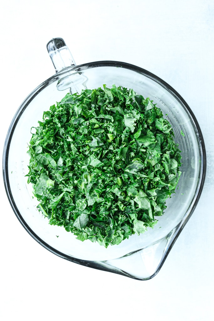 kale finely chopped in a glass measuring cup